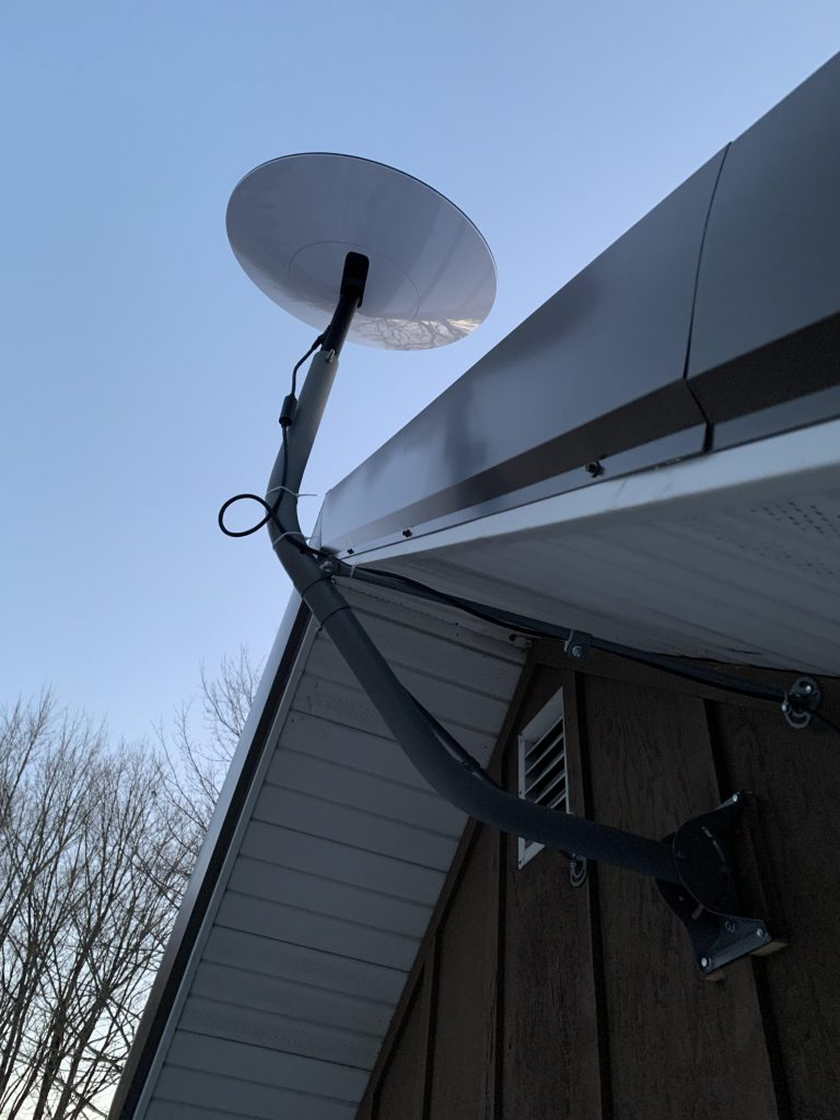 "Starlink's Phased-Array Antenna ""Dishy"" Mounted on the Roof of a House in Michigan"